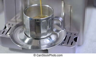 coffee maker fills cup of coffee - Coffee maker fills cup of...