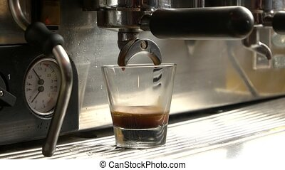Coffee making machine, close up. Male hand, glass with...