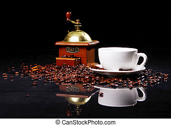Coffee mill on the table with coffee beans around - Coffee ...