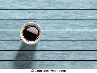 Coffee mug on turquoise wooden table 3d render