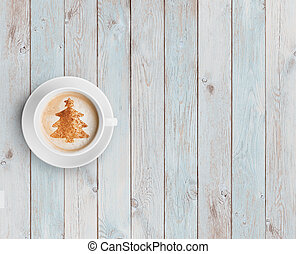 coffee mug with christmas tree on white wood table