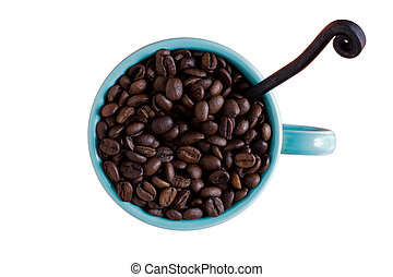 Coffee mug with coffee beans isolated on white