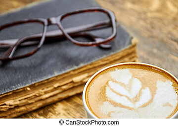 Coffee, old book and glasses.