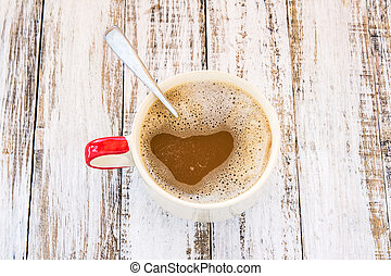 Coffee on a white wooden background