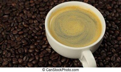 Coffee on coffee beans 1080p HD video