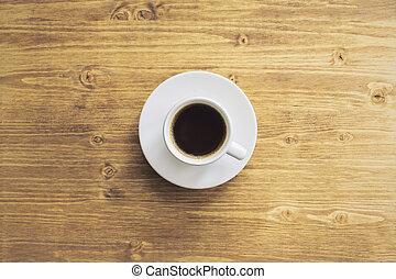 Coffee on desk topview