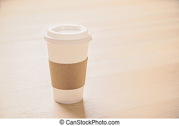 Coffee on light wood - Plastic coffee cup on light wooden ...