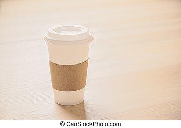 Coffee on light wood - Plastic coffee cup on light wooden ...