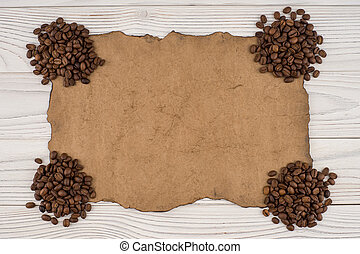 Coffee on old paper and wooden table. Top view.