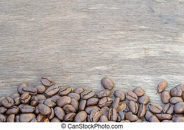 Coffee on old wooden background