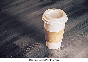 Coffee on table - Plastic coffee cup on wooden table. Mock ...