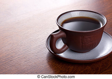 Coffee on the wood background