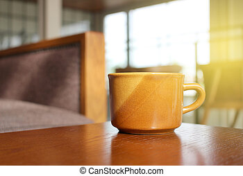 Coffee on wooden table with burst light