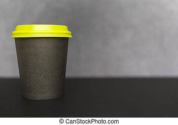 Coffee paper cup on gray blurred background