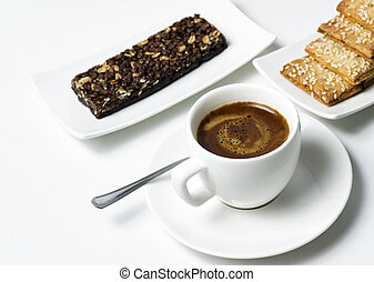 coffee pleasure - coffee cup with cereal dessert on white...