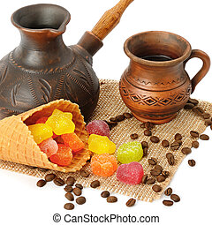 Coffee pot, cup of coffee, jujube and waffles isolated on white background