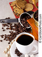 coffee pot, sweets, cup and grinder