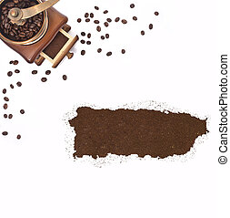 Coffee powder in the shape of Puerto Rico and a coffee mill.(series)