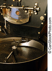 A large coffee roaster, just before the beans are extracted and slowly stirred in the cooling cylinder.