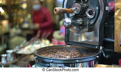 Coffee roasting machine at street coffee shop. ...