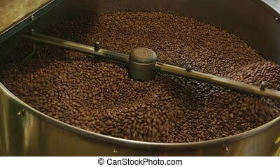 Coffee roasting machine in motion.