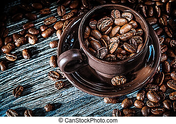 Coffee seeds cup saucer on wooden board