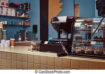 Coffee shop bar and counter with coffee equipment.