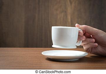 Coffee cup on hand