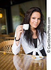 Coffee shop girl. - Gorgeous young brunette hanging out at...