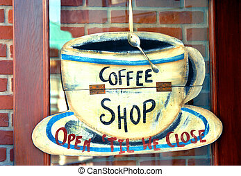 Coffee Shop - Humorous coffee shop sign is attached to cafe...