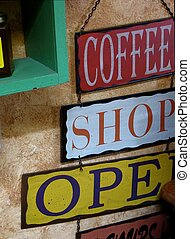 Coffee Shop Open Sign - Colorful sign displayed on textured...