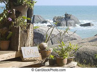 Coffee shop sign on a tropical island