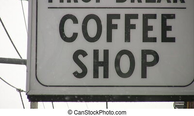 Coffee shop sign. - Coffee shop sign with snow falling....