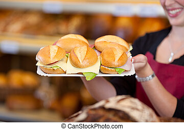 Coffee Shop Worker Holding Tray Full Of Burgers - Midsection...