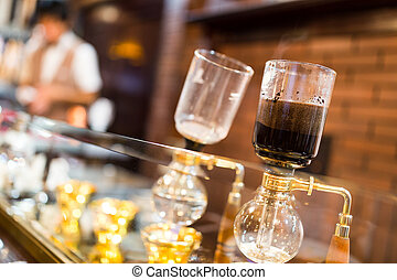 Coffee siphon in use
