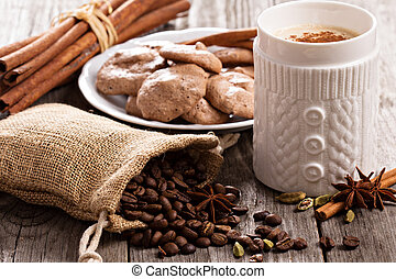 Coffee, spices and chocolate meringue cookies on wood
