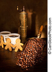 Coffee still-life - Antique coffee grinder with steaming...