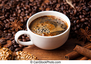 coffee still life - cup of black coffee and cinnamon sticks ...