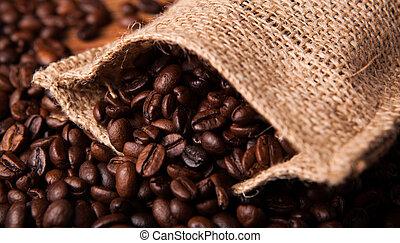 roasted coffee beans and coffee bag closeup