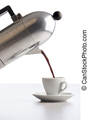 coffee - pouring coffee from coffeepot into white coffee...