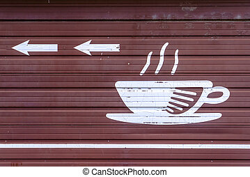 Coffee This Way illustration sign on brown surface