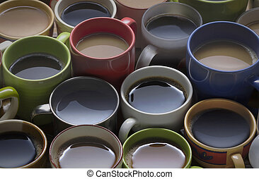 coffee time - lots of coffee in different cups on wooden table good background for text or graphic design. coffee lover - lots of coffee cup in different cups.