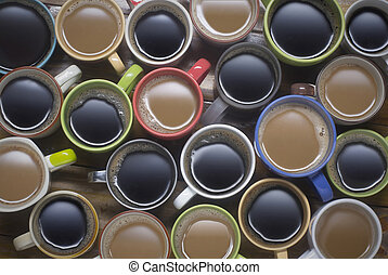 coffee time - many cups of coffee on wooden table good background for text or graphic design. coffee lover - lots of coffee cup in different cups - top view