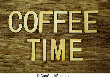 Coffee Time text message on wooden background