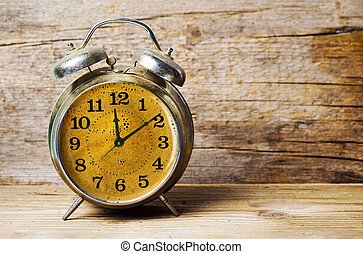 Coffee time. Vintage clock with black coffee background