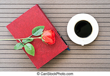 Coffee time with book, coffee cup, red rose