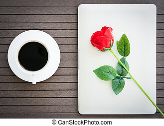 Coffee time with laptop, coffee cup, red rose