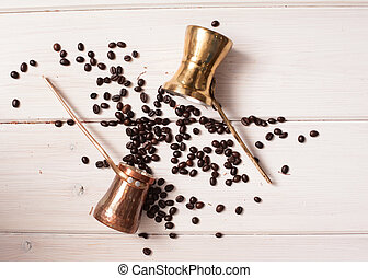 Coffee turk with beans on desk