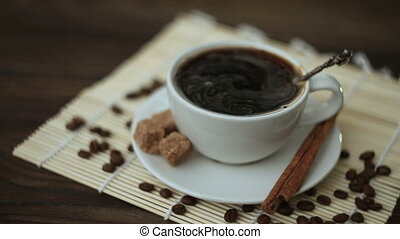 coffee with cinnamon in white cup on table