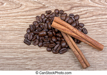 Coffee with cinnamon on a wooden background